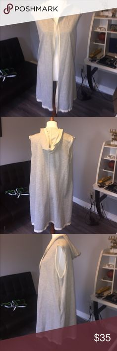 "Knit hoodie sleeveless NWOT ***Price Firm**** super comfy staple sleeveless sweatshirt hoodie duster w/pockets chest 22"" length 34"" very light weight not like thick sweatshirt fabric color heather grey and cream (not Lularoe just need exposure) brand is 180 degrees sold in boutiques made in USA 50/50 cotton poly LuLaRoe Tops Sweatshirts & Hoodies"