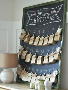 Here's another chalkboard advent calendar idea. Small brown packets are filled with festive treats. You will find small clothes pegs at craft and hobby stores