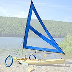 Serenity Upwind Kayak Sail and Canoe Sail System (Blue). Complete with Telescoping Mast, Boom, Outriggers, Lee Boards, All Rigging Included! Sailing Kayak, Kayak Boats, Canoe And Kayak, Kayak Fishing, Boat Building Plans, Boat Plans, Outrigger Canoe, Kayak Storage