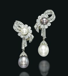 A PAIR OF NATURAL PEARL AND DIAMOND EAR PENDANTS   The tops designed as baguette-cut diamond ribbons centering upon a white or a grey-brown button-shaped natural pearl in a brilliant-cut diamond partial surround, suspending a white or a grey-brown drop-shaped natural pearl, with diamond-set cap, 5.5 cm, with French assay marks for platinum and gold