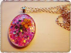 Small oval pendant by Glitz Blizzard.  http://www.facebook.com/glitzblizzard