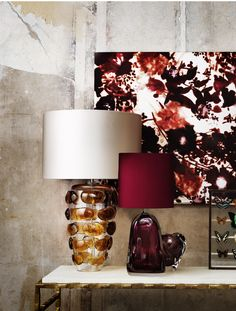 Blob lamp, Perfume Bottle lamp and Peony vase, shot on a Giacometti console table. Products by Porta Romana