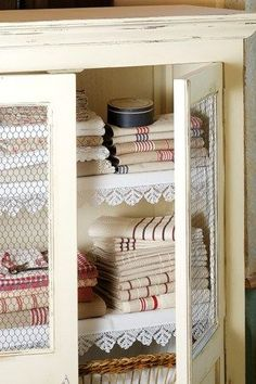 Paint up and pretty up an older cabinet to store linens , or towels for a bathroom, or for guests to use in a guest room.