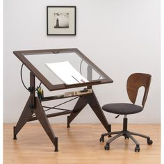 The Aries Glass Top Drafting Table by Studio Designs offers a sophisticated, versatile work space for the home or office. In handsome Sonoma Brown, the table adjusts in height up to 34.75 inches and angle from flat to 75 degrees.