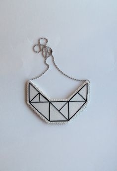 Small embroidered geometric bib necklace on by AnAstridEndeavor