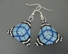Beautiful beadwoven, peyote earrings! Made of Japanese delica beads in brown and turquoise. The sides of the triangle are 1(2,6cm)long, the entire earring is about 1.3/4 (4,5cm)long from the top of the earwire. Your choice of antique copper or sterling silver ear wires. Check out my other beaded earrings in many different styles, designs and colors: http://www.etsy.com/shop/MadeByKatarina?section_id=6203080 Please contact me if you have any questions. Thank y...