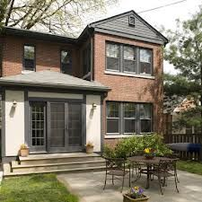 dark grey windows on red brick house - Google Search