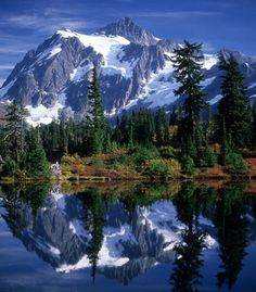 """Mt. Shuksan reflected in Picture Lake in Washington's North Cascades."" (From: 30 Travel-Inspiring Photos of Mountains)"