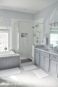 River Rock Shower Floor, Recessed Shower Niche with Hexagon Marble Tiles.  Amazing Real-Life Master Bathroom Renovation!  Carrara Marble, Square Chrome Fixtures, Grey Paint, Painted Cabinets, White Towels, PotteryBarn Lighting & Mirrors, Diagonal Tile, Kohler Soaker Tub with Chromotherapy & More!  Stacy's Savings Total Home Makeover.