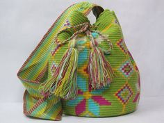 This one of a kind mochila bag is entirely hand-woven by artisans of the Wayuu community from Colombia. Each bag is the result of the skills and