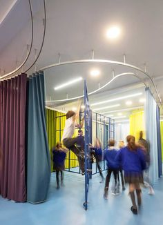 aberrant architecture reconfigures london school with sculptural rails and colored curtains