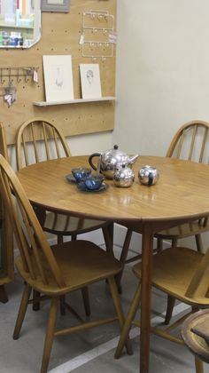 Retro Ercol style dining set. Drop leaf table and Four Windsor Dining Chairs. Perfect for your next project.