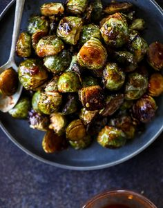These sweet and spicy brussels sprouts are roasted to perfect and the most delicious side dish! It's a great way to elevate regular old brussels sprouts and make a fantastic side to to serve on a weeknight! Sprout Recipes, Vegetable Recipes, Vegetarian Recipes, Cooking Recipes, Healthy Recipes, Thai Recipes, Clean Recipes, Asian Brussel Sprouts, Gastronomia