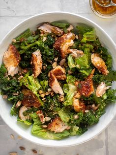 Ginger Salmon Salad - Roasted Salmon Salad with Hot Ginger Dressing - - This ginger salmon salad has the flaky, flavorful roasted salmon on top of kale and romaine, drizzled with warm ginger vinaigrette. Salmon Recipes, Seafood Recipes, Dinner Recipes, Seafood Dishes, Tasty Meal, Great Lunch Ideas, Hot Bacon Dressing, Ginger Salmon, Vinaigrette