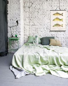 bedroom - brick wall and frameless bed.. love it