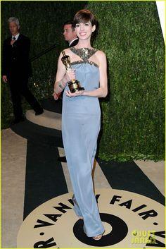 "Anne Hathaway.    Vanity Fair Oscars Party.    ""custom-made Saint Laurent dress"""