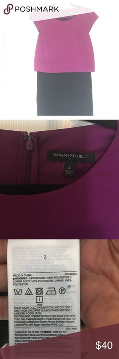 Size 2 Banana Republic Dress One piece dress but looks like a top and a skirt. Top is a dark magenta short sleeve, hook and zipper enclosure on back, skirt is black and pleated. I just noticed what looks like 2 ink dots on the back of top, barely at all noticeable. Worn once Banana Republic Dresses Midi