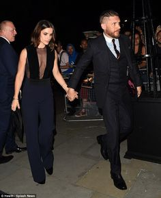 Holding hands: The sweet couple were pictured leaving the event together