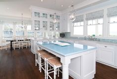 How to Bring Natural Light into your Dark Kitchen: Double sided glass cabinet doors over peninsulas.