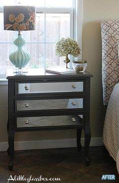 I thought the dresser was cute before but this is gorgeous. I love the glass they added to the drawers. I'm also really digging that lamp!