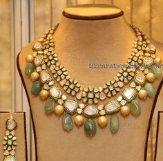 22 carat gold kundan necklace with flower shaped motifs attached at the top row and square shaped large atones attached in the bottom. Gr...