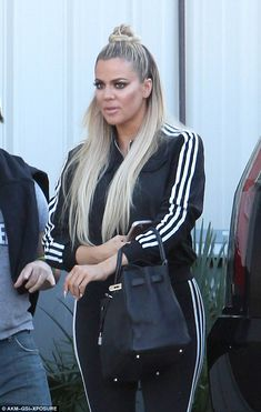 Blondes have more fun: The reality star wore her long extensions in a half-updo