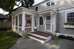 Screening room porch traditional with wood siding window boxes