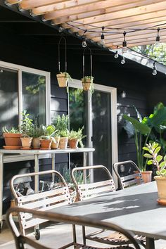 black house with wood pergola and industrial string lights / sfgirlbybay - back yard insp Black Pergola, Curved Pergola, Metal Pergola, Pergola Patio, Pergola Plans, Pergola Ideas, Rustic Pergola, Small Outdoor Spaces, Outdoor Rooms