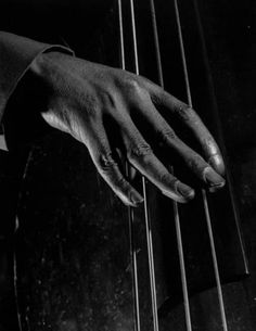 An unidentified bass player's fingers [1943] by Gjon Mili