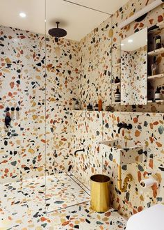 colorful terrazzo bathroom in blue, red and yellow is a bold and cheerful solution