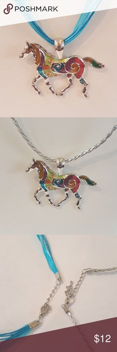 ONE Horse pendant with two color necklaces Beautiful horse pendant with a teal necklace and a silver rope both necklaces are included with the pendant. Jewelry Necklaces