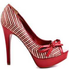 Add summer spice to your closet with this woven beauty by Paris Hilton.  Beth features a red and cream textile upper accented by a sleek patent bow at the vamp.  Perfecting this breezy look is a patent 5 inch heel and 1 inch platform.