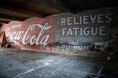 Coca-Cola ghost sign uncovered by a work crew inside a building at the corner of First and Shepherd Streets in Lufkin, Texas. This slogan was used in 1907 and 1908. You can see this sign inside the Standpipe Coffee Shop.
