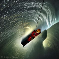 Photo by @shonephoto (Robbie Shone) - Deep inside the Gorner glacier Switzerland a member of our team of Italian explorers ascends a rope in a narrow slot through the beautifully sculptured ice. As a result of the movement of the glacier such moulins don't exist for long it is therefore important to carry out thorough documentation as next year this cave will be gone. by natgeo
