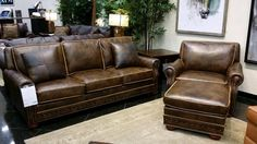 This high quality leather sofa with matching chair and ottoman would be a great style addition to your space. This set does not skimp on comfort with its smooth leather and large cushions.  Come check it out at Gallery Furniture, TODAY! | Houston TX | Gallery Furniture |