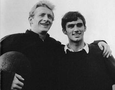 Circa 1963/64. Manchester United star man Denis Law welcoming a young winger, George Best, to the first team squad