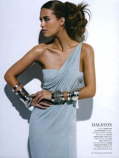 grecian glamour.  Love the shoulder & neck detail (or lack of) and fitting shows off the hourglass