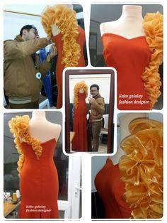 Dress kako galalay fashion designer.  Orange dress
