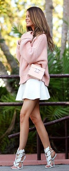 Anette Haga is wearing a knitted blush pink sweater