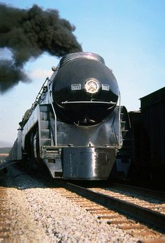 Norfolk Southern operated Norfolk & Western streamlined J class 4-8-4 Northern steam locomotive # 611, with it's railfan train is seen in the yard at Atlanta, Georgia, October 1989...
