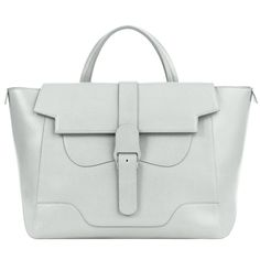Versatile luxury handbag capable of anything. Wear as satchel, tote, crossbody, or backpack with room for a laptop. Genuine pebbled leather with suede interior.