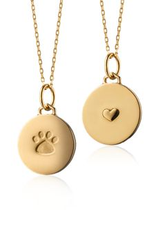 Carry your love for your four-legged family member with this paw print charm pendant forged of 18k yellow gold | Monica Rich Kosann