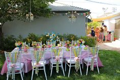 Garden party bridal shower.  Fabric decorated chairs