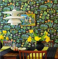 Great paper....fun art that they put with it.  Looks like a hokey little print or needlework of kids in folk costumes.  Not what you would expect in such a contemporary room but...it works!