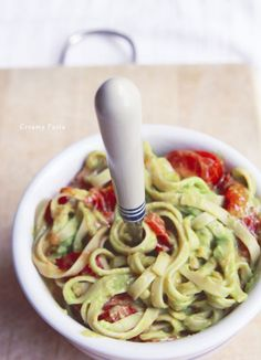 Creamy Avocado Pasta 🍈 Like Alfredo, but healthy 🍈 10-12 small Campari tomatoes, quartered; 3-4 TBsp olive oil; 4 servings of fettuccine noodles; 2 ripe avocados, seed and skin removed; 2 garlic cloves, peeled; ½ tsp salt; 2 TBsp lemon juice; ¼c pine nuts; grated fresh Parmesan cheese 🍈 if you want to increase the protein,add some grilled chicken.