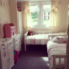 This is our twin girls toddler bedroom after changing a few things in the room. We wanted to keep it with a shabby chic ditsy design. Our house is quite small so have been very limited with a small bedroom space for them. The beds are white with pink and blue bedding and they turn into bunk beds for when they are older.