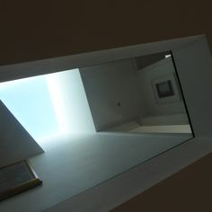 Roof light flooding light through the glass floor below. Natasha Marshall Blog