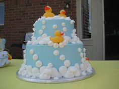A two tier ducky cake.  Where would you like to go next:  View more Rubber Ducky Cakes   Visit our Ducky Baby Shower Theme Page   Go back to Baby Shower