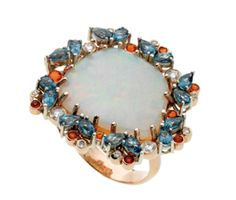 Opal surrounded by fire opals, white and  cognac diamonds and blue topaz set in 18k rose gold