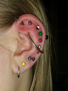 Or I can put a large ring through my outer conch and around my whole ear (don't really like this one, just tried it out for fun).